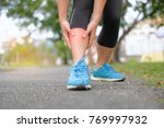 young fitness woman holding her ... | Shutterstock . vector #769997932