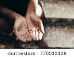 Small photo of Selective focus. hands poor child begging you for help.children sitting in slum.concept for poverty or hunger people, Human Rights,background text.