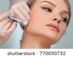 woman is getting filler... | Shutterstock . vector #770050732