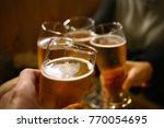 a beer toast | Shutterstock . vector #770054695