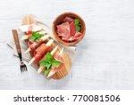 fresh melon with prosciutto and ... | Shutterstock . vector #770081506