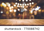 wood table top with blur of... | Shutterstock . vector #770088742
