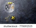 martini cocktail on dark stone... | Shutterstock . vector #770092525