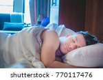 man sleeping alone at the hotel ... | Shutterstock . vector #770117476