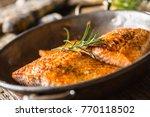 two juicy salmon steaks in... | Shutterstock . vector #770118502