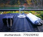 table outdoor at riverside | Shutterstock . vector #770150932
