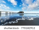 pile dwelling on the beach in... | Shutterstock . vector #770182912
