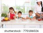 group of children and teacher... | Shutterstock . vector #770186026
