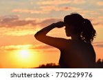 young woman in sunset light ...   Shutterstock . vector #770229976