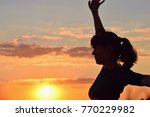 young woman in sunset light ...   Shutterstock . vector #770229982