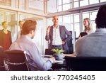 senior man talking to employees ... | Shutterstock . vector #770245405