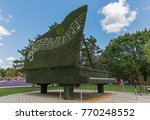 Small photo of GATINEAU, CANADA – AUGUST 27, 2017: A sculpture of a piano at the MOSAICANADA 150 exhibition celebrating the 150 anniversary of Canada.