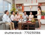 parents giving chinese new year ... | Shutterstock . vector #770250586