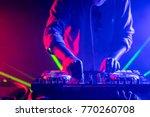 Stock photo dj playing music on light background 770260708