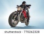 biker in black jacket and... | Shutterstock . vector #770262328