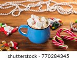 cup of cocoa with marshmallow... | Shutterstock . vector #770284345