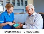 nurse helping senior man to... | Shutterstock . vector #770292388