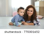 cute baby and young mother at... | Shutterstock . vector #770301652
