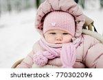 a little girl sitting in... | Shutterstock . vector #770302096