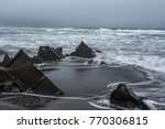 waves wash the wreckage of the... | Shutterstock . vector #770306815