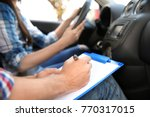 driving instructor writing down ... | Shutterstock . vector #770317015