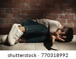helpless little boy lying on... | Shutterstock . vector #770318992