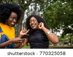 afro descent girls using... | Shutterstock . vector #770325058