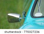 blue car on a green field | Shutterstock . vector #770327236