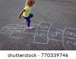 little girl playing hopscotch... | Shutterstock . vector #770339746
