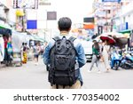 young independent tourist man... | Shutterstock . vector #770354002