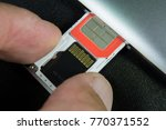 inserting or removing sim card... | Shutterstock . vector #770371552