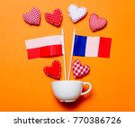 white cup and heart shapes with ... | Shutterstock . vector #770386726