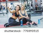 young sportive women taking...   Shutterstock . vector #770393515