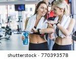 sportive women with towels... | Shutterstock . vector #770393578