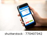 hand holding smartphone showing ... | Shutterstock . vector #770407342