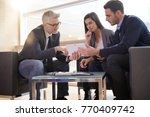 real estate agent explaining... | Shutterstock . vector #770409742