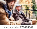 senior father in wheelchair and ... | Shutterstock . vector #770413342