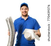 worker in blue uniform with...   Shutterstock . vector #770439376