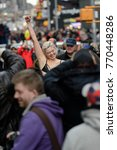 Small photo of At the end of the Real Catwalk show model, activist, and event organizer Khrystana raises her fist in celebration in Times Square, December 2, 2017.
