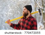 lumberjack in the woods with an ...   Shutterstock . vector #770472055