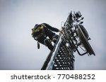 telecom worker climbing antenna ... | Shutterstock . vector #770488252