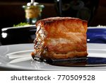 roasted pork belly with red wine | Shutterstock . vector #770509528