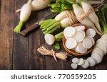 White Organic Radishes On The...