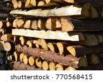 firewood pile wooden background | Shutterstock . vector #770568415
