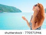 woman applying sunscreen... | Shutterstock . vector #770571946