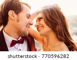 the girl smiles at her fiance... | Shutterstock . vector #770596282
