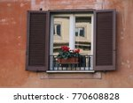 window with the flowers italy | Shutterstock . vector #770608828