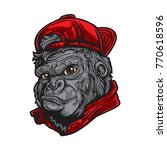 cartoon gorilla wearing red hat.... | Shutterstock .eps vector #770618596