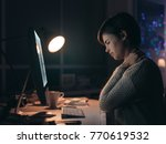 young woman working with her... | Shutterstock . vector #770619532