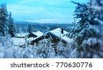 finland christmas cabin in woods   Shutterstock . vector #770630776